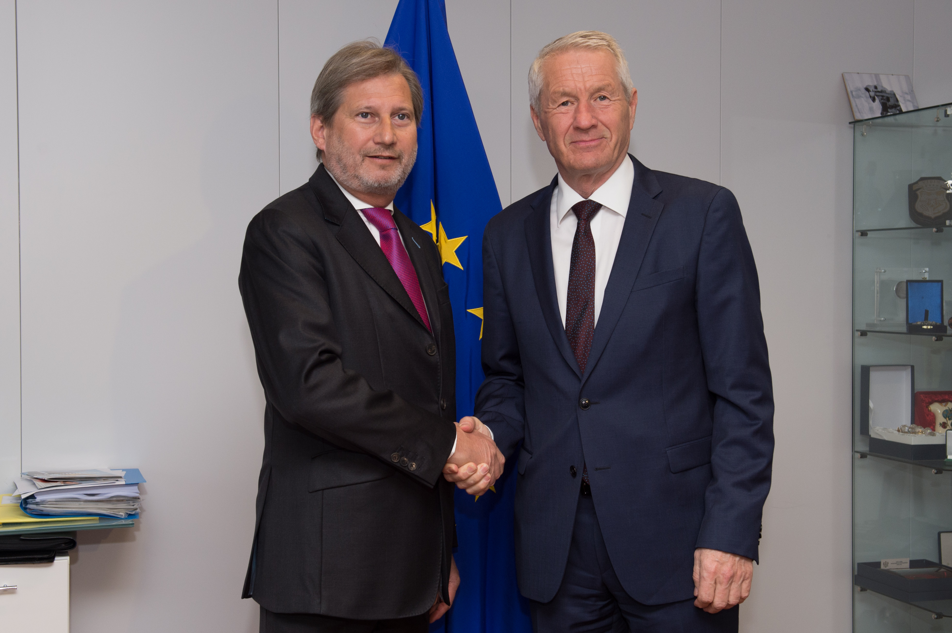 Thorbjorn Jagland, on the right, was received by Johannes Hahn